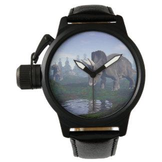 El caminar de dos dinosaurios de relojes de mano
