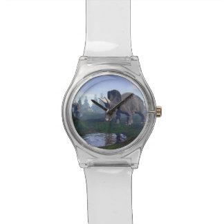 El caminar de dos dinosaurios de relojes de pulsera