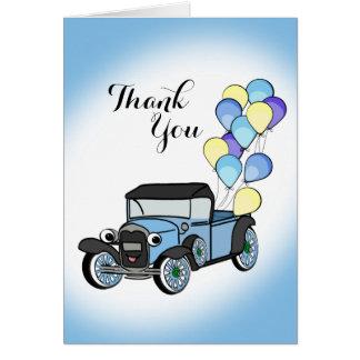 El camión antiguo con los globos le agradece tarjeta