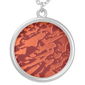 El cobre del oro grabado en relieve agita la hoja  colgante redondo