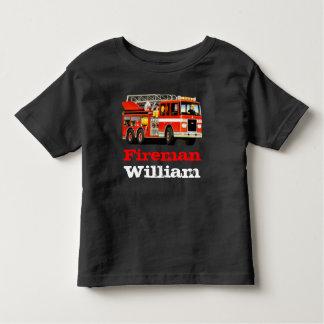 El coche de bomberos rojo conocido de encargo del camiseta de bebé