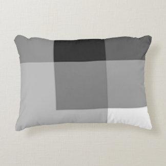 El color gris sombrea la almohada del acento por