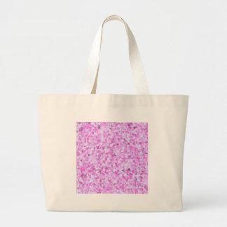 El confeti rosado de la pintada de la plantilla bolsas