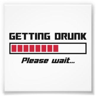 El conseguir bebido por favor espera la barra de foto