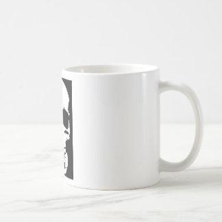El cráneo negro y blanco del arte pop elegante se taza de café