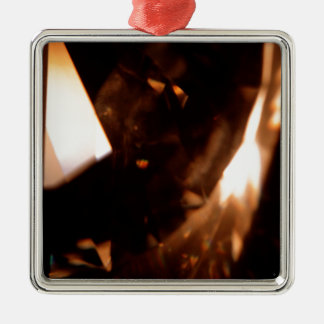 El cristal abstracto refleja el triángulo adorno de navidad