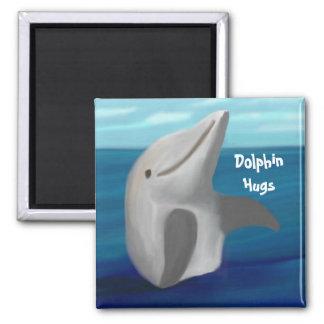 El delfín abraza el imán