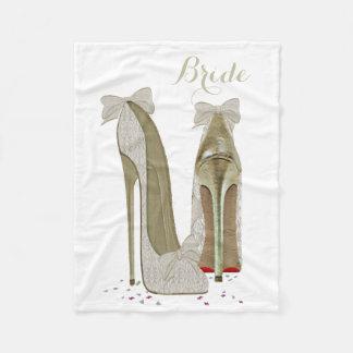El estilete de la novia calza la manta del paño