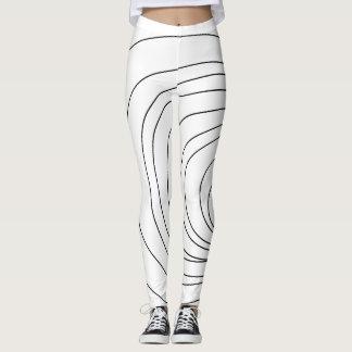 El extracto blanco y negro alinea las polainas leggings