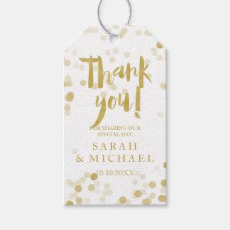 El falso confeti de la hoja de oro le agradece etiquetas para regalos