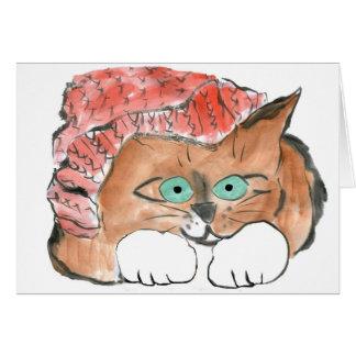 El gatito lleva un gorra de punto de la gorrita te tarjeta de felicitación