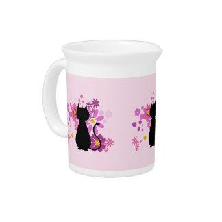 El gato en rosa florece el jarro/la jarra
