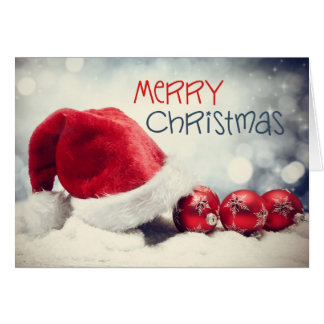 El gorra de Santa adorna la tarjeta de