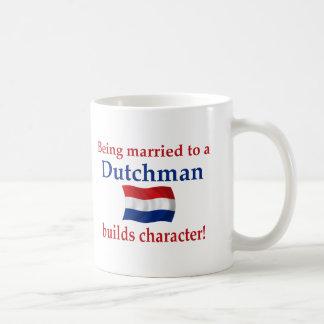 El holandés construye el carácter taza de café