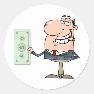 El hombre de negocios muestra el dólar grande pegatina redonda