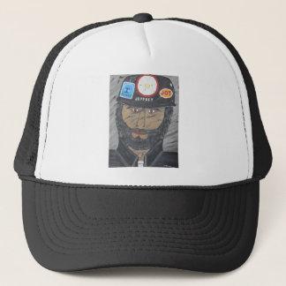 El hombre del carbón gorra de camionero