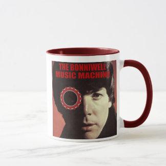 El hombre en la máquina taza