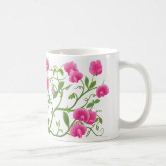 El jardín del guisante de olor florece la taza