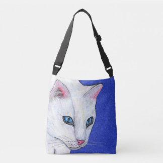 El jefe de los ojos azules claros del gato blanco bolsa cruzada