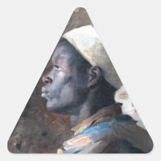 El jefe del orientalista de un joven amarra pegatina triangular