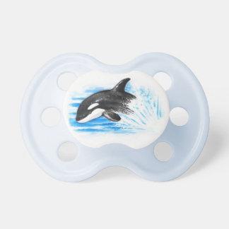 El jugar de la orca chupete de bebe