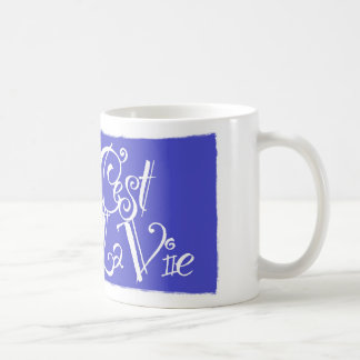 El La de C'est compite la taza