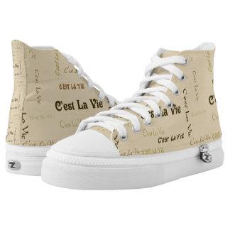 El la de C'est del café compite hola los zapatos