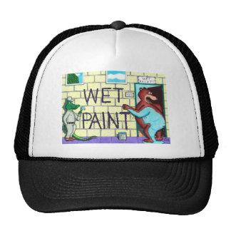 El lío mojado de la pintura gorras
