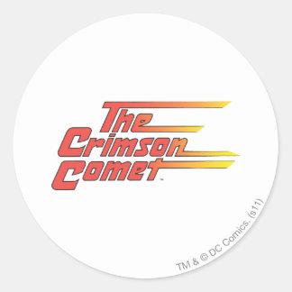 El logotipo carmesí del cometa pegatina redonda