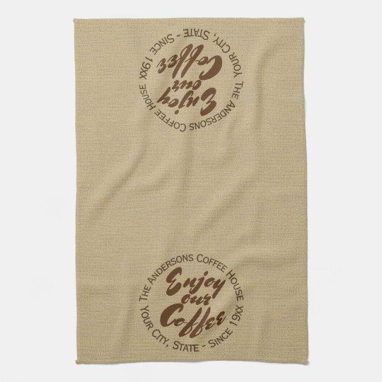 """El logotipo de la cafetería """"goza de nuestro toalla"""