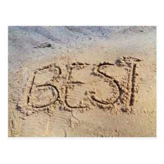 El mejor, palabra en arena en la playa soleada, postal