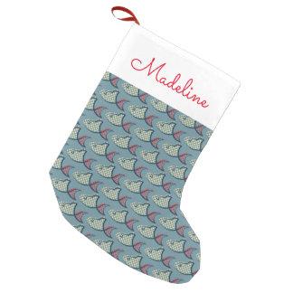 El modelo el | de los pescados del lunar añade su calcetín de navidad pequeño