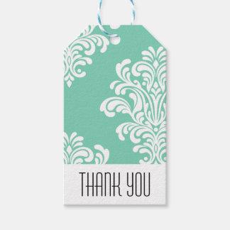 El modelo elegante del damasco le agradece etiquetas para regalos