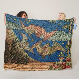 El mosaico golpea la manta del paño grueso y suave