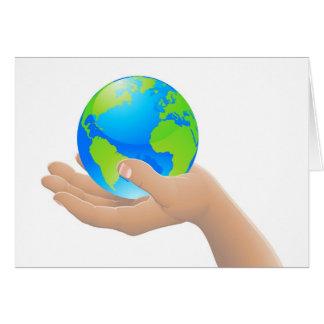 El mundo en su concepto de la mano felicitacion