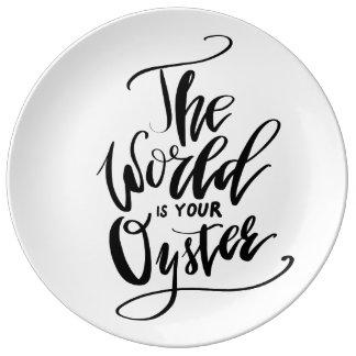 El mundo es su ostra plato de porcelana