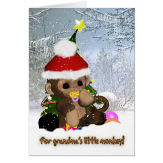 El navidad del nieto - el pequeño mono de la tarjeta de felicitación