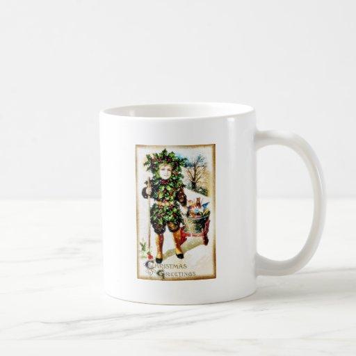 El navidad que saluda con un muchacho trae la cest taza