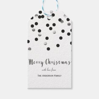 El negro del confeti y el regalo de plata de las etiquetas para regalos