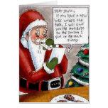 El niño divertido soborna la tarjeta de Navidad de