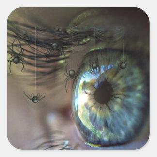 El ojo místico con la araña azota en usted al pegatina cuadrada