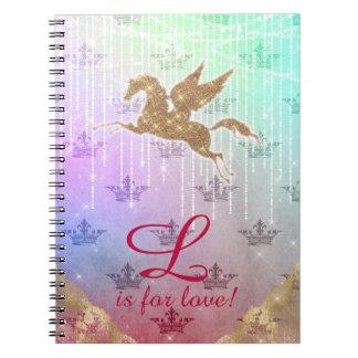 El oro del purpurina del unicornio enciende la cuaderno