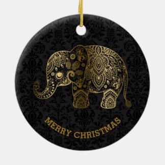 El oro entona el elefante floral en los damascos adorno navideño redondo de cerámica