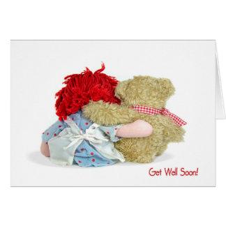 El oso de peluche y la muñeca de trapo consiguen tarjeta de felicitación