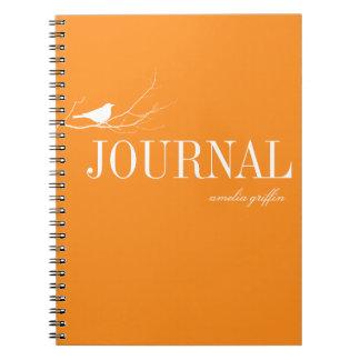 El pájaro se encaramó en el diario de encargo anar libros de apuntes con espiral