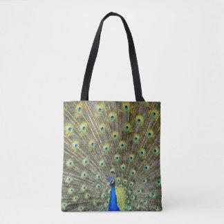 El pavo real empluma el bolso de compras hermoso