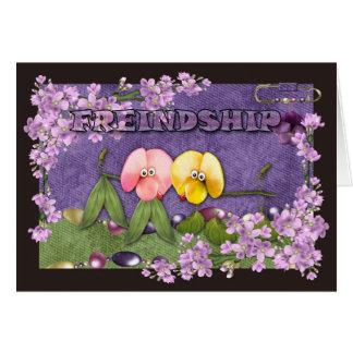 El pequeño perro de la amistad florece lindo tarjeta de felicitación