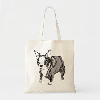 El perrito de Boston Terrier adentro suda el bolso