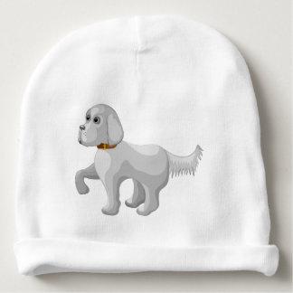 El perro da la pata gorrito para bebe