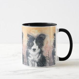 El perro del border collie, ennegrece la taza